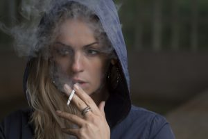 Woman has plastic surgery in Calgary - is it safe to smoke now?